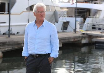 """Actor Richard Gere poses during a photocall for a TV serie """"Motherfatherson"""" as part of the MIPCOM, on October 15, 2018 in Cannes, southeastern France. (Photo by VALERY HACHE / AFP)        (Photo credit should read VALERY HACHE/AFP via Getty Images)"""