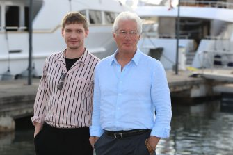 """US actor Richard Gere (R) and British actor Billy Howle pose during a photocall for a TV serie """"Motherfatherson"""" as part of the MIPCOM, on October 15, 2018 in Cannes, southeastern France. (Photo by VALERY HACHE / AFP)        (Photo credit should read VALERY HACHE/AFP via Getty Images)"""