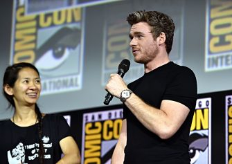 SAN DIEGO, CALIFORNIA - JULY 20: Director Chloe Zhao and Richard Madden of Marvel Studios' 'The Eternals' at the San Diego Comic-Con International 2019 Marvel Studios Panel in Hall H on July 20, 2019 in San Diego, California. (Photo by Alberto E. Rodriguez/Getty Images for Disney)