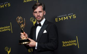 "LOS ANGELES, CALIFORNIA - SEPTEMBER 15: Jakob Ihre poses in the press room with the award for outstanding cinematography for a limited series or movie for ""Please Remain Calm"" during the 2019 Creative Arts Emmy Awards on September 15, 2019 in Los Angeles, California. (Photo by JC Olivera/WireImage)"