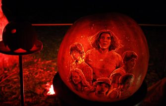 epa07950233 A carved pumpkin depicting characters from the television show Stranger Things is displayed during the Night of the 1,000 Jack-o'-Lanterns on Governors Island in New York, USA, 25 October 2019. The Night of the 1,000 Jack-o'-Lanterns sees some of the USA's best pumpkin sculptors carve pumpkins to celebrate the lead up to Halloween.  EPA/JASON SZENES