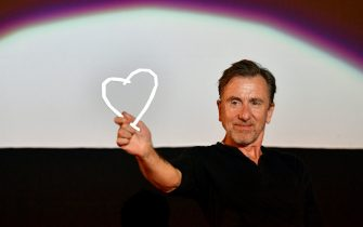 "TOPSHOT - British actor and film director Tim Roth poses with his ""Heart of Sarajevo"" award at the Open Air Cinema of the 25th Sarajevo Film Festival, in Sarajevo, Bosnia and Herzegovina, on August 20, 2019. - Tim Roth was awarded a ""Honorrary Heart of Sarajevo"" for his exceptional contribution to the art of film. This year's Festival runs from August 16 to 23 and features 270 movies from 56 countries. (Photo by ELVIS BARUKCIC / AFP)        (Photo credit should read ELVIS BARUKCIC/AFP via Getty Images)"