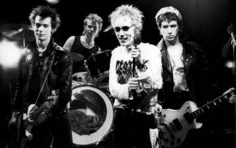 UNITED KINGDOM - JUNE 01:  Photo of SEX PISTOLS; Group portrait on the set of the Pretty Vacant video shoot L-R Sid Vicious, Paul Cook, Johnny Rotten (John Lydon) and Steve Jones  (Photo by Virginia Turbett/Redferns)