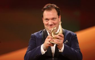 "30 October 2020, Saxony, Leipzig: Actor Charly Hübner receives the Golden Hen in the acting category during the television gala ""Goldene Henne"". The audience award is presented for the 26th time. It is awarded to stars from music, sports and show business. Photo: Jan Woitas/dpa-Zentralbild/dpa (Photo by Jan Woitas/picture alliance via Getty Images)"