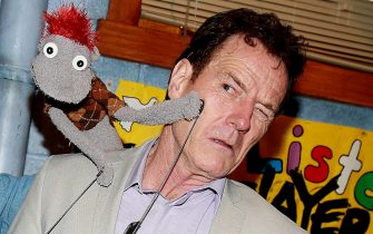 """NEW YORK, NY - JUNE 05:  """"Tyrone"""" (the demonic sock puppet) and Bryan Cranston pose backstage at the hit play """"Hand to God"""" on Broadway at The Booth Theater on June 5, 2015 in New York City.  (Photo by Bruce Glikas/FilmMagic)"""
