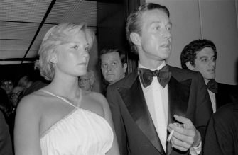 Close-up of photojournalist Susan Ford and Halston (born Roy Halston Frowick, 1932 - 1990) as they arrive at the Four Seasons (for a Martha Graham reception), New York, New York, May 17, 1977. (Photo by Allan Tannenbaum/Getty Images)