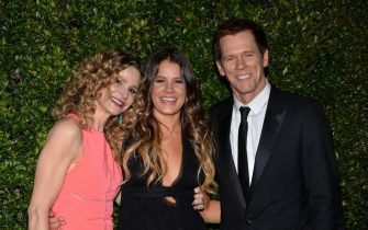 BEVERLY HILLS, CA - JANUARY 12:  (L-R) Actors Kyra Sedgwick, Sosie Bacon and Kevin Bacon arrive at the FOX/FX Golden Globe Party at the FOX Pavilion at the Golden Globes on January 12, 2014 in Beverly Hills, California.  (Photo by Amanda Edwards/WireImage)