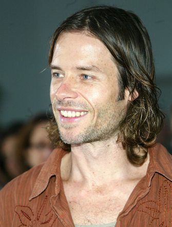 """HOLLYWOOD, CA - APRIL 22:  Actor Guy Pearce attends the world premiere of the Lion's Gate film """"Godsend"""" at the Mann's Chinese Theatre on April 22, 2004 in Hollywood, California. (Photo by Frederick M. Brown/Getty Images)"""
