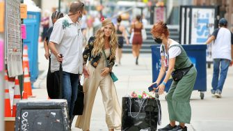 Sarah Jessica Parker wears a vintage Claude Montana linen jumpsuit from Replika Vintage with a floral jacket, a feather hat  and multicolored heeled sandals on the set of 'And Just Like That' in New York CityPictured: Sarah Jessica ParkerRef: SPL5238789 130721 NON-EXCLUSIVEPicture by: Christopher Peterson / SplashNews.comSplash News and PicturesUSA: +1 310-525-5808London: +44 (0)20 8126 1009Berlin: +49 175 3764 166photodesk@splashnews.comWorld Rights,