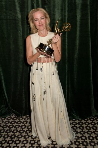 LONDON, ENGLAND - SEPTEMBER 19: Gillian Anderson accepts the award for outstanding Supporting Actress In A Drama Series for The Crown attends the Netflix celebration of the 73rd Emmy Awards at 180 The Strand on September 19, 2021 in London, England.  (Photo by David M. Benett/Dave Benett/Getty Images for Netflix)