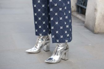 LONDON, ENGLAND - FEBRUARY 16: Fashion influencer Emily Hart Valentine wears an H&M trousers and New Look boots on day one of London Womens Fashion Week Autumn/Winter 2018, on February 16, 2018 in London, England. (Photo by Kirstin Sinclair/Getty Images)