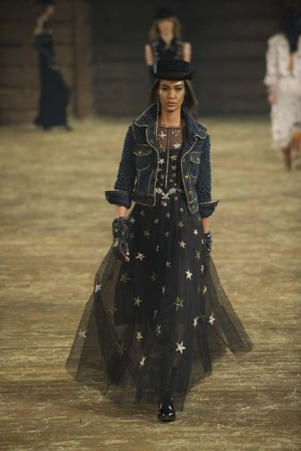 """DALLAS, TX - DECEMBER 10:  Model Joan Smalls walks the runway during the Chanel """"Metiers d'Art"""" Show at Fair Park on December 10, 2013 in Dallas, Texas.  (Photo by Cooper Neill/Getty Images for Chanel)"""