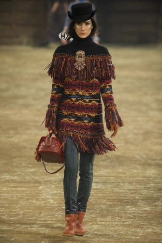 """DALLAS, TX - DECEMBER 10:  A model walks the runway during the Chanel """"Metiers d'Art"""" Show at Fair Park on December 10, 2013 in Dallas, Texas.  (Photo by Cooper Neill/Getty Images for Chanel)"""