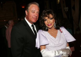 "NEW YORK, NY - MAY 04:  John James and Joan Collins (who co-starred on ""Dynasty"" together) pose at the Friars Club salute to Joan Collins at The Friars Club on May 4, 2015 in New York City.  (Photo by Bruce Glikas/FilmMagic)"