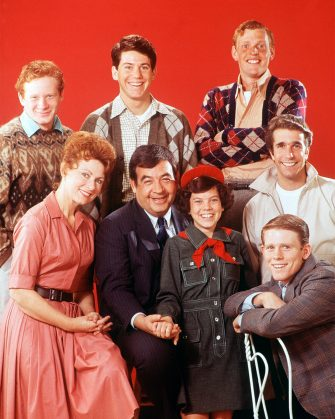 """UNITED STATES - JANUARY 15:  HAPPY DAYS - Gallery - Season One - 1/15/74, One of the most successful series of the 1970s was """"Happy Days"""", which was set in the late 1950s, early 1960s in Milwaukee. """"Happy Days"""" told the story of the Cunninghams, pictured, bottom left: Marion (Marion Ross) and Howard (Tom Bosley), the parents of Joanie (Erin Moran), Richie (Ron Howard, bottom right) and Chuck (original actor Gavan O'Herlihy, top right, was replaced by Randolph Roberts in 1974, before Chuck went to college and was never seen again). Richie's friends were Ralph (Donny Most, top left) and Potsie (Anson Williams, top center). Henry Winkler (center, right) played Fonzie, who moved into a small apartment over the Cunningham garage.,  (Photo by Bob D'Amico/Walt Disney Television via Getty Images)"""
