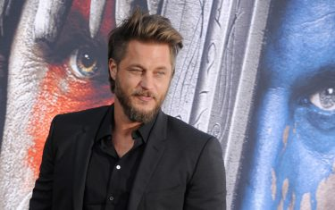 """HOLLYWOOD, CA - JUNE 06:  Actor Travis Fimmel arrives at the premiere of Universal Pictures' """"Warcraft"""" at TCL Chinese Theatre IMAX on June 6, 2016 in Hollywood, California.  (Photo by Gregg DeGuire/WireImage)"""