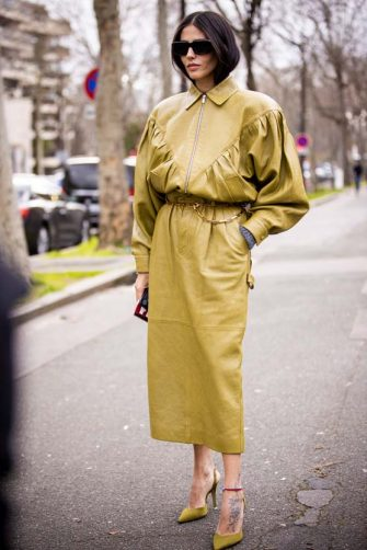 PARIS, FRANCE - MARCH 03: Gilda Ambrosio, wearing an acid green leather jacket with matching midi skirt and acid green heels, is seen outside Miu Miu, during Paris Fashion Week - Womenswear Fall/Winter 2020/2021 : Day Nine on March 03, 2020 in Paris, France. (Photo by Claudio Lavenia/Getty Images)