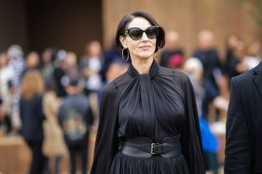 PARIS, FRANCE - SEPTEMBER 24: Monica Bellucci wears sunglasses, a black pleated dress, outside Dior, during Paris Fashion Week - Womenswear Spring Summer 2020, on September 24, 2019 in Paris, France. (Photo by Edward Berthelot/Getty Images)