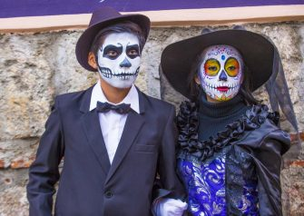 Participants on a carnival of the Day of the Dead in Oaxaca, Mexico. (Photo by: Kobby Dagan/VW Pics/Universal Images Group via Getty Images)