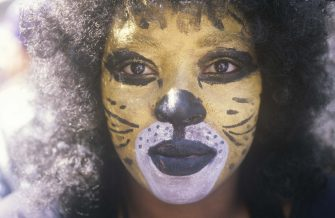 African-American Female in Cat Makeup, New Orleans, Louisiana (Photo by: Joe Sohm/Visions of America/Universal Images Group via Getty Images)