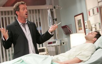 """HOUSE:  House (Hugh Laurie, L) searches for the correct diagnosis for a professional cyclist (Kristoffer Polaha, R) who has been enhancing his performance in the HOUSE episode """"Spin"""" airing Tuesday, Nov. 15 (9:00-10:00 PM ET/PT) on FOX.  ª©2005 Fox Broadcasting Co.  Cr:  Chris Hasten/FOX."""
