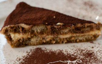 """TREVISO, ITALY - AUGUST 24:  A slice of Tiramisu is seen at the Restaurant """"Alle Beccherie on August 24, 2013 in Treviso, Italy. Treviso claims that Tiramisu was invented in the 1970s by Ada Campoel, the owner of the restaurant called """"Alle Beccherie"""", who supposedly wanted to create a dessert that would give her an energy boost after the birth of her son.  (Photo by Marco Secchi/Getty Images)"""