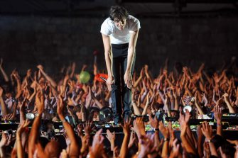 """(FILES) This file picture taken on July 16, 2008 in La Rochelle, western France shows English-Lebanese singer Mika performing on the stage at the Francofolies music festival. After the success of """"Life in Cartoon Motion,"""" which sold five million copies worldwide, Mika released a second album on September 11, 2009, inspired by his adolescence and 1980s pop -- """"The Boy Who Knew Too Much."""" Throughout the album, the artist brings to mind Freddie Mercury, George Michael and Jimmy Sommerville, but it is the British production trio Stock, Aitken and Waterman who are most strongly evoked. AFP PHOTO / XAVIER LEOTY (Photo credit should read XAVIER LEOTY/AFP via Getty Images)"""