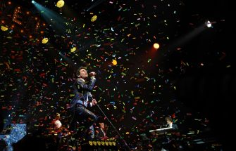 """TOPSHOT - British-Lebanese singer and songwriter Mika performs during the 40th edition of """"Le Printemps de Bourges"""" rock and pop music festival in Bourges on april 12, 2016. (Photo by GUILLAUME SOUVANT / AFP)        (Photo credit should read GUILLAUME SOUVANT/AFP via Getty Images)"""