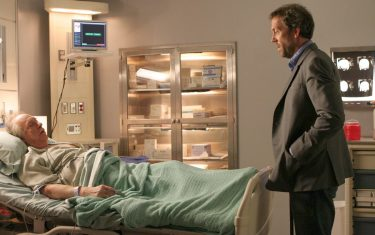 """HOUSE:  House (Hugh Laurie, R) races against time to find a donor heart for a dying patient (guest star Howard Hessman, L) in the HOUSE episode """"Sex Kills"""" airing Tuesday, March 7 (9:00-10:00 PM ET/PT) on FOX.  ©2006 Fox Broadcasting Co.  Cr:  Carin Baer/FOX"""