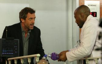 """HOUSE: House (Hugh Laurie, L) and Foreman (Omar Epps, R) treat a teenage girl (guest-star Michelle Trachtenberg, L) who recently had a heart transplant in the HOUSE episode """"Safe"""" airing Tuesday, April 4 (9:00-10:00 PM ET/PT) on FOX.  Also pictured:  Guest star Michelle Trachtenberg (C).  ©2006 Fox Broadcasting Co.  Cr:  Michael Becker/FOX"""
