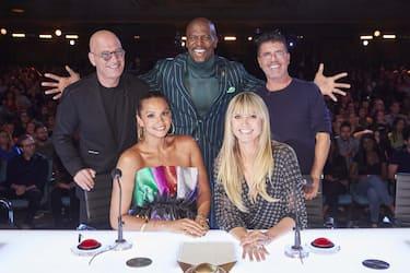"AMERICA'S GOT TALENT: THE CHAMPIONS -- ""The Champions Four"" Episode 204 -- Pictured: (l-r) Howie Mandel, Alesha Dixon, Terry Crews, Heidi Klum, Simon Cowell -- (Photo by: Trae Patton/NBC)"