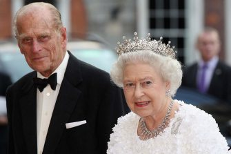 DUBLIN, IRELAND - MAY 18:  Queen Elizabeth II and Prince Philip, Duke of Edinburgh arrive to attend a State Banquet in Dublin Castle on May 18, 2011 in Dublin, Ireland. The Duke and Queen's visit to Ireland is the first by a monarch since 1911. An unprecedented security operation is taking place with much of the centre of Dublin turning into a car free zone. Republican dissident groups have made it clear they are intent on disrupting proceedings.  (Photo by Oli Scarff/Getty Images)