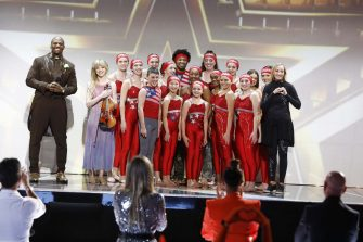 """AMERICA'S GOT TALENT: THE CHAMPIONS -- """"The Champions Finale Results"""" Episode 207 -- Pictured: (l-r) Terry Crews, Lindsey Stirling, Silhouettes -- (Photo by: Trae Patton/NBC)"""