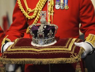 The Imperial State Crown, due to be worn by Brtain's Queen Elizabeth II during her traditional speech for the State Opening of Parliament, is pictured during the annual State Opening of Parliament in London, on November 18, 2009. British Prime Minister Gordon Brown unveiled a crackdown on the banking industry Wednesday as part of a voter-friendly agenda designed to boost its chances at elections barely six months away. In a traditional Queen's Speech detailing its final legislative plans before ballots due by June, the government also put boosting growth and jobs as its top priority as Britain emerges from the global slowdown. AFP PHOTO/TOBY MELVILLE/WPA POOL  (Photo credit should read TOBY MELVILLE/AFP via Getty Images)