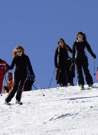 VERBIER, SWITZERLAND - FEBRUARY 16:  Sarah, Duchess Of York, With Her Daughters, Princess Beatrice And Princess Eugenie Enjoying A Ski-ing Holiday Together In Verbier.  (Photo by Tim Graham Photo Library via Getty Images)