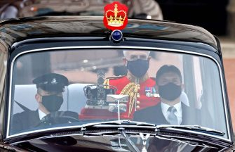 The Imperial State Crown is driven from Buckingham Palace to the Houses of Parliament for the State Opening of Parliament in London on May 11, 2021, which is taking place with a reduced capacity due to Covid-19 restrictions. - The State Opening of Parliament is where Queen Elizabeth II performs her ceremonial duty of informing parliament about the government's agenda for the coming year in a Queen's Speech. (Photo by Tolga Akmen / AFP) (Photo by TOLGA AKMEN/AFP via Getty Images)