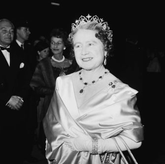 The Queen Mother (1900 - 2002) attends a performance at RADA (the Royal Academy of Dramatic Art), to celebrate the drama school's Diamond Jubilee (60th anniversary), London, UK, November 1964. (Photo by Terry Disney/Express/Getty Images)