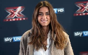 Gaia Gozzi, della categoria Under Donne, posa per i fotografi a margine della conferenza stampa di presentazione della nuova edizione di X Factor, Milano, 26 ottobre 2016.  ANSA / MATTEO BAZZI
