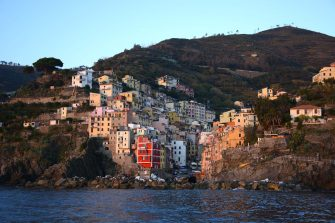 RIOMAGGIORE, ITALY - NOVEMBER 1, 2015: The colorful seaside town of Riomaggiore on Italy's northwest coast is one of five villages which comprise the Cinque Terre region popular with tourists. The string of centuries-old villages on the rugged Italian Riviera coastline, and the surrounding hillsides, are all part of the Cinque Terre National Park and is a UNESCO World Heritage site. (Photo by Robert Alexander/Getty Images)