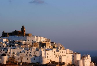 OSTUNI - SALENTO - ITALY, AUGUST 13: A view of Ostuni (called also the white town) on August 13, 2007, in Salento, Italy. Salento is that strip of land that forms the heel of the boot (lo Stivale). It is located between two seas: the Ionic (Ovest) and the Adriatic (East). There are more than 250 Km of coast which is at times low and sandy and at times high and indented. Salento is a peninsular region belonging to the South-eastern part of Puglia.  (Photo by Franco S. Origlia/Getty Images)