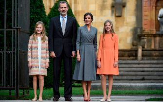 Princess Leonor of Spain (L) poses with her parents king Felipe VI and queen Letizia, and sister princess Sofia (R) outside the Oviedo cathedral on October 17, 2019 on the eve of the Princess of Asturias awards ceremony. (Photo by MIGUEL RIOPA / AFP) (Photo by MIGUEL RIOPA/AFP via Getty Images)