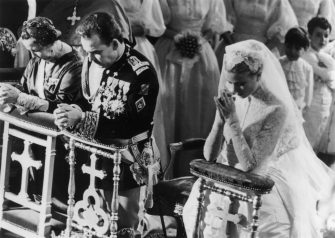 19th April 1956:  Prince Rainier of Monaco with his bride, Her Most Serene Highness Princess Grace Patricia (1929 - 1982) (Grace Kelly), praying during their wedding service in Monaco Cathedral.  (Photo by George W. Hales/Fox Photos/Getty Images)