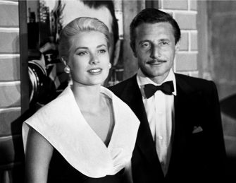 AUGUST 1: Actress Grace Kelly and fashion designer Oleg Cassini attend the premiere of the movie 'Rear Window' which was released on August 1, 1954. (Photo by Frank Worth, Courtesy of Capital Art/Getty Images)
