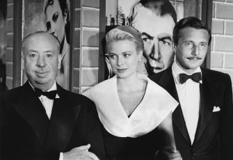AUGUST 1:  Dircetor Alfred Hitchcock, actress Grace Kelly and fashion designer Oleg Cassini attend the premiere of the movie 'Rear Window' which was released on August 1, 1954. (Photo by Frank Worth, Courtesy of Capital Art/Getty Images)