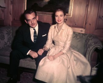 """Original caption: 1/5/56-Philadelphia, PA: Prince Rainier III of Monaco and lovely Grace Kelly, reigning """"Queen"""" of the American screen, pose for photographers at the home of Miss Kelly's parents after the pair's engagement was announced Jan 5, 1956. The wedding plans were disclosed to more than 40 American and European reporters and 25 photographers and cameramen at a news conference in the Kelly's red brick home. The couple announced they would be married shortly after Easter."""