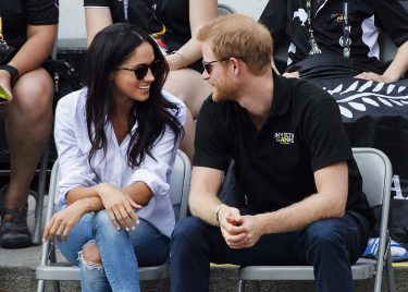 Prince Harry and his girlfriend Meghan Markle attend the wheelchair tennis competition during the Invictus Games in Toronto on Monday, Sept. 25, 2017. (Nathan Denette/The Canadian Press via AP)