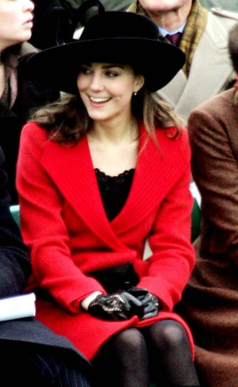 Kate Middleton watches from the stands, as graduates of the Royal Military Academy, Sandhurst,  including Britain's Prince William, pass out during the Sovereign's parade at the academy,  near  Camberley,  England, Friday Dec. 15, 2006. (AP Photo/Tim Ockenden, pool)