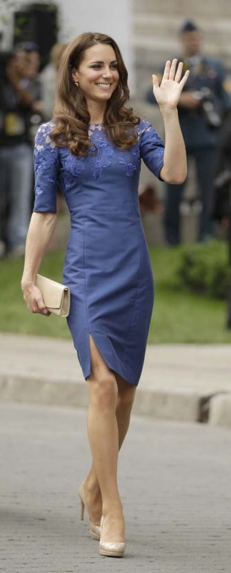 Kate, the Duchess of Cambridge, waves to the crowd after a ceremony at Quebec City Hall as the Royal couple continue their Royal Tour of Canada Sunday, July 3, 2011, in Quebec City, Canada. (AP Photo/Charlie Riedel)