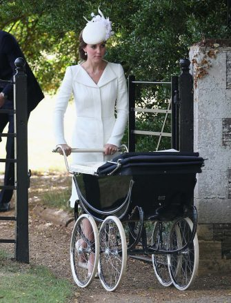 Kate, the Duchess of Cambridge pushes Princess Charlotte of Cambridge in her pram they leave the Church of St Mary Magdalene on the Sandringham Estate, England, after her christening,  Sunday, July 5, 2015. (Chris Jackson, Pool Photo via AP)