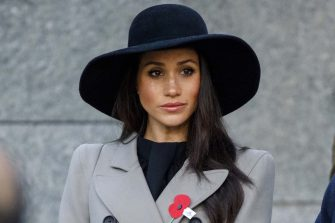 Meghan Markle attends an Anzac Day dawn service with Britain's Prince Harry, at Hyde Park Corner in London, Wednesday, April 25, 2018. ANZAC Day commemorates the moment when Australian and New Zealand Army Corps troops waded ashore at the Gallipoli peninsula in Turkey 103 years ago in their first major battle of World War I. (Tolga Akmen/Pool Photo via AP)